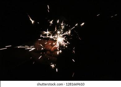 Sparkler in someone's hand.