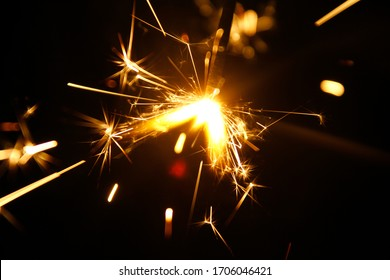 Sparkler is a type of hand held firework that burns slowly while emitting colored flames, sparks, and other effects