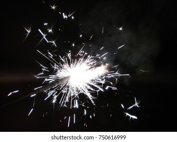Sparklers for Christmas and New Year celebrations. Welcome to 2018.Happy New Year. Abstract background of Black and White.
