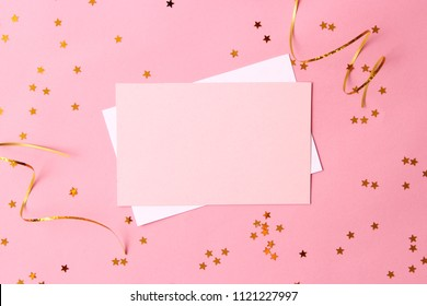 sparkles confetti and card for inserting text on a colored background top view. Minimalism, design, insta, holiday. flatlay