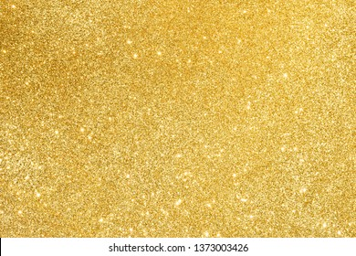 sparkles of golden glitter abstract background