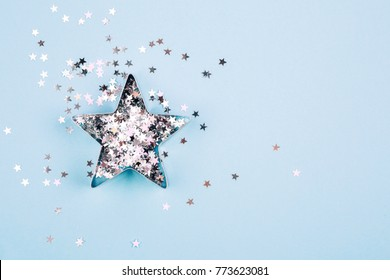 with sparkles and shapes for gingerbread on blue pastel background. Flat lay style. Concept of celebrating new year. Christmas mood.
