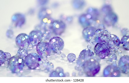 Sparkling beads in purples and blues.