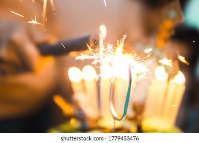 Sparkling birthdaycake candles orange glow