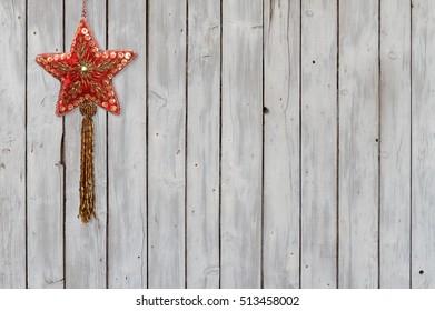 Sparkling Christmas Star Velvet Ornament on Weathered Wooden Background