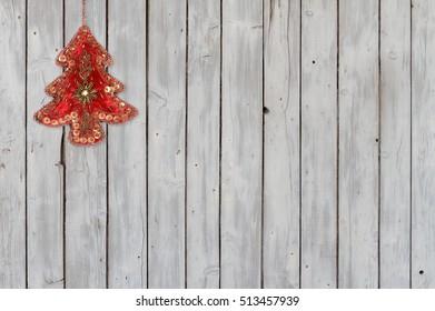 Sparkling Christmas Tree Velvet Ornament on Weathered Wooden Background