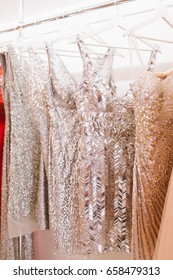Sparkling dresses hanging in a wardrobe.