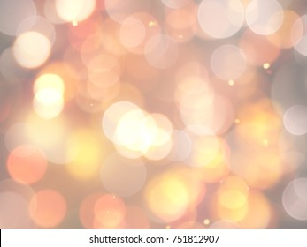 Sparkling gold effect warm blurred festive party lights background