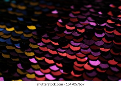 Sparkling holiday macro background of bright shiny sequins and lusters