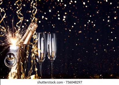 Sparkling New Year background. Champagne Explosion With Toast Of Flutes