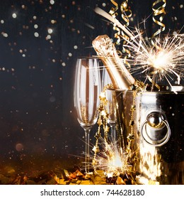 Sparkling New Year background. Champagne Explosion With Toast Of Flutes. Party Feeling with Sparklers and Champagne. New Years Eve celebration