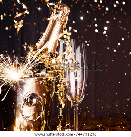 sparkling new year background champagne explosion with toast of flutes party feeling with sparklers
