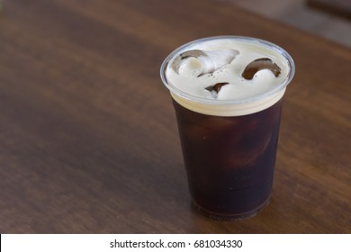 Sparkling Nitro Cold Brew Coffee on table outdoor cafe ready to drink.Nitro Cold brew is a coffee adding Nitrogen gas.