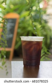 Sparkling Nitro Cold Brew Coffee on table outdoor cafe ready to drink