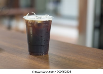 Sparkling Nitro Cold Brew Coffee in plastic take away cup ready to drink
