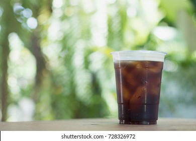 Sparkling Nitro Cold Brew Coffee ready to drink.Outdoor cafe in tropical design.