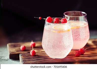 Sparkling pink raspberry lemonade on dark background