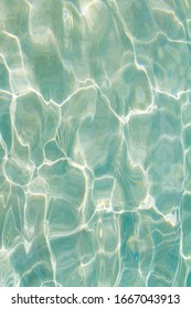 sparkling shiny waves in blue water background