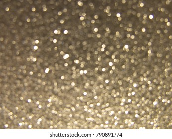 Sparkling silver background with sparkles and bokeh