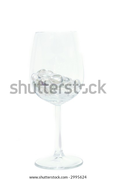 Sparkling stones in a wine glass isolated on white