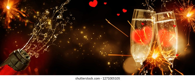 Sparkling wine in the bottle and hearts in the glasses