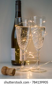 Sparkling wine on new years eve with decorative lights