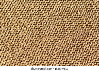 Sparkly gold background fabric texture knitted in reverse stocking stitch