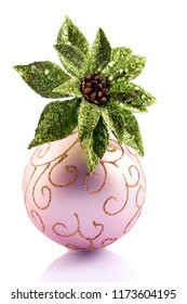"""A sparkly green poinsettia in a pink Christmas bulb """"vase"""".  Isolated on white."""