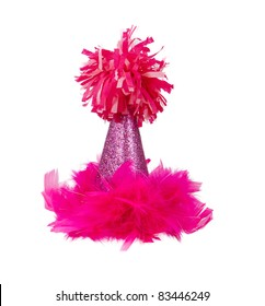 A sparkly pink birthday party hat with feathers and a pom pon