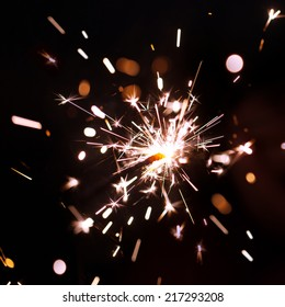 Sparks of Bengal fire on a black background