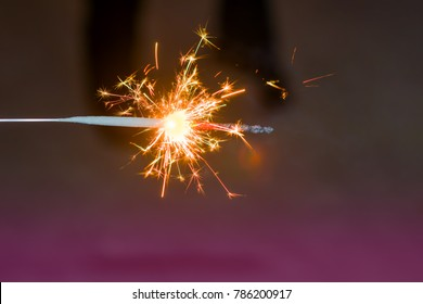 Sparks Bengali festive burning fire in the dark night background, abstract Christmas background