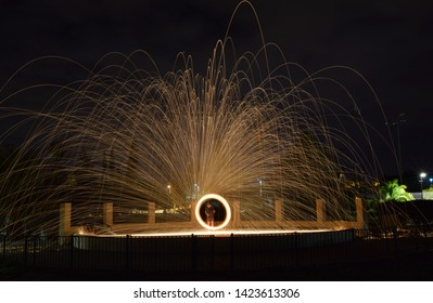 Sparks created by Bernd steel wool in a long exposure shote, Sparks created yellow orang faire spiral in the dark, Steel wool photography,  Iron wool, Wire wool, Steel wire, Wire sponge