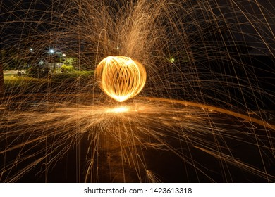 Sparks created by Bernd steel wool in a long exposure shote, Sparks created yellow orang faire boll in the dark, Steel wool photography,  Iron wool, Wire wool, Steel wire, Wire sponge