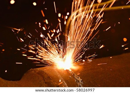 Sparks during cutting of metal by gas welding