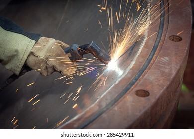 Sparks during cutting of metal manual plasma cutting machine