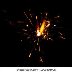 Sparks of fire on a black background welding fireworks.