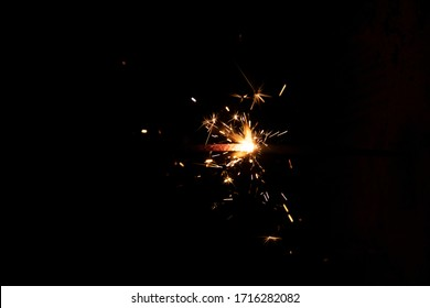 sparks from fireworks in the dark