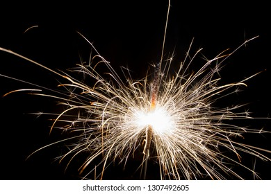Sparks from fireworks, sparklers on a black background, close-up. Celebration.