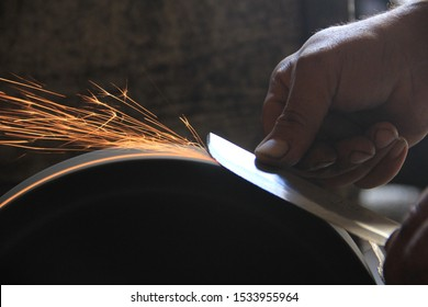 Sparks grinding wheel while knife sharpening