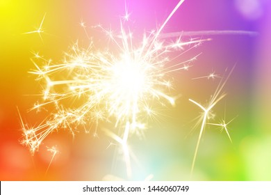 Sparks from hand cold fireworks bright sunspot colorful background