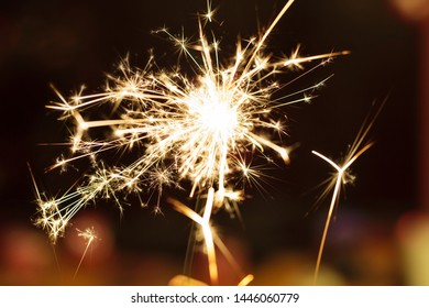 Sparks from hand cold fireworks color background