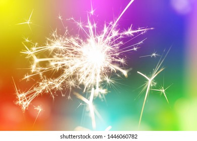 Sparks from hand cold fireworks colorful background