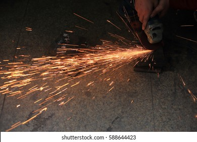 sparks  made by using electric disc  grinder polishing the surface