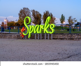 Sparks, Nevada / USA - September 29, 2019: Lighted City of Sparks sign on the beach of the Sparks Marina park at sunrise in early autumn.
