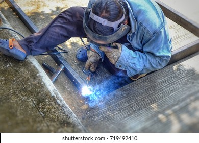 Sparks, smoke from welding of steel