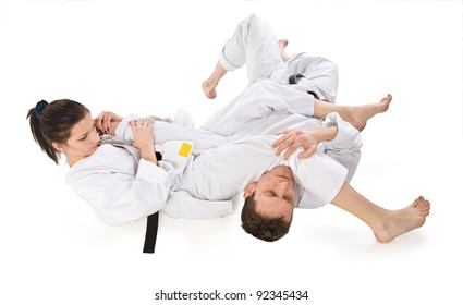 Sparring.Sport.Karate.Training fight.two fighters on a white background
