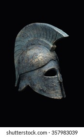 Spartan military helmet in the background