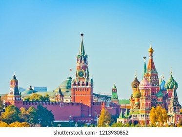 Spasskaya Tower and Cathedral of Vasily the Blessed (Saint Basil's Cathedral) in sunny autumn day. Red Square. Moscow. Russia