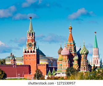 Spasskaya Tower of Moscow Kremlin and Cathedral of Vasily the Blessed (Saint Basil's Cathedral) in sunny day. Red Square. Moscow. Russia