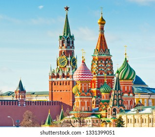 Spasskaya Tower of Moscow Kremlin and the Cathedral of Vasily the Blessed (Saint Basil's Cathedral) on Red Square. Sunny winter day. Moscow. Russia